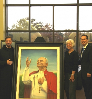 12. On the vigil of Pope John Paul II's first feast day as a saint, on October 21, 2014, Benedictine College chaplain Father Brendan Rolling and President Stephen Minnis unveiled a portrait of John Paul II by Dawn Gardner for the JPII Student Center.
